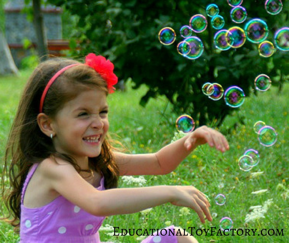 This little girl is loving her bubbles. If you even wondered how to make bubble solution at home, you're in luck.
