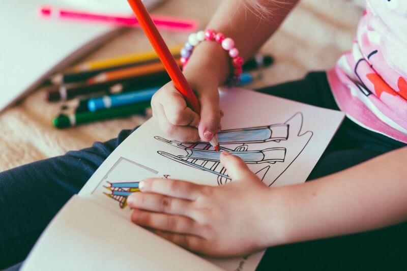 Child having fun coloring