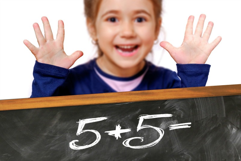 Girl showing a math result with her hands