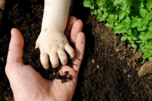 father-daughter-playing-with-soil